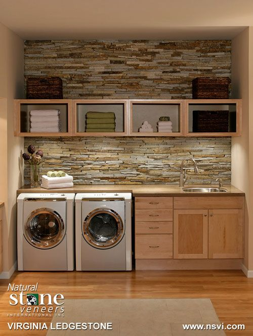 Organized laundry with brick backsplash....