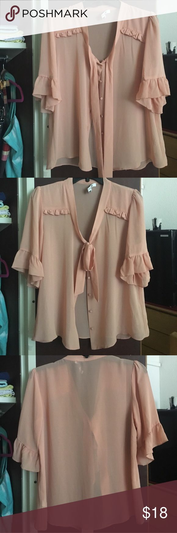 Forever 21 top Peachy top from F21 | Sheer fabric, features buttons and cute frilly details | SZ L, but I wear a S-M and it fits oversized | great condition *Please note the inside label in the first photo | labeled ASOS for views ASOS Tops Blouses
