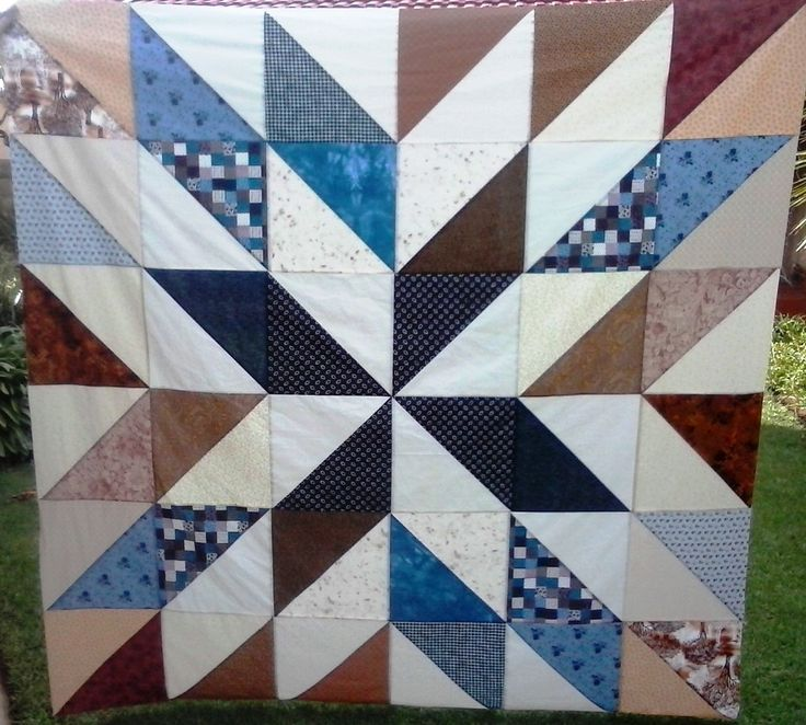 Half-Square Triangle quilt in blues and browns