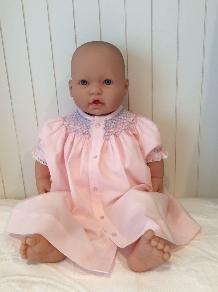 A personal favorite from my Etsy shop https://www.etsy.com/listing/539953568/pink-hand-smocked-baby-dress-newborn