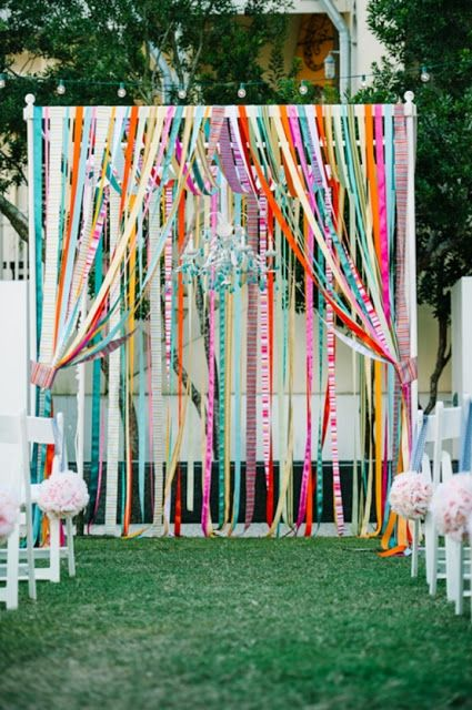 Colorful wedding altar or multicolored ribbons. We would do this as a simple arch, and not a 4 post chuppah.