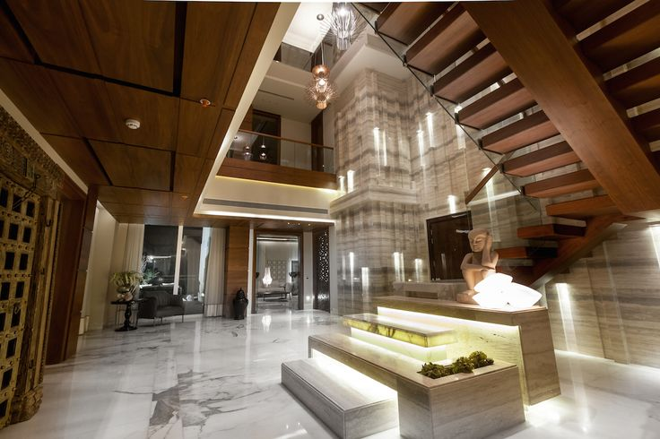 Double height foyer at a 25 th floor penthouse designed for Foyer designs flats
