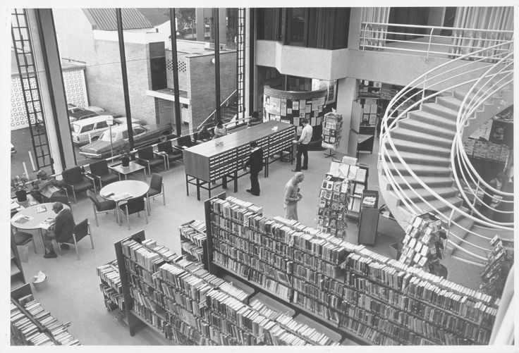 Interior of Willoughby City Library, Chatswood, 1983. From first floor looking down to the adult fiction, reading area and card catalogue.