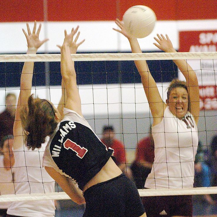 Niceville's Liz Schaick goes up for a block from a hit by Fort Walton Beach's Kat Williams during the District 1-5A volleyball final at Fort Walton Beach. The Vikings won in five games. Daily News file photo, Oct. 21, 2005.