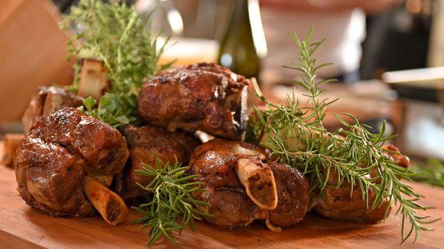 "Lidia Bastianich adapted Rita Moreno's traditional Christmas roast pig into this Braised Pork Shanks with Fennel recipe, also known as ""Stinchi di Maiale Brasati con Finocchio""."