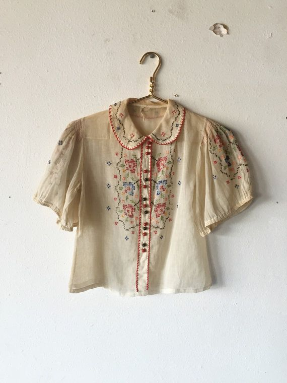 1930s cotton gauze peasant blouse with cross stitch embroidery through front bodice, sleeves, and around the peter pan collar.