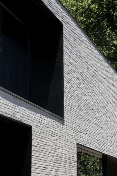 Fine bricks and metal surroundings around windows