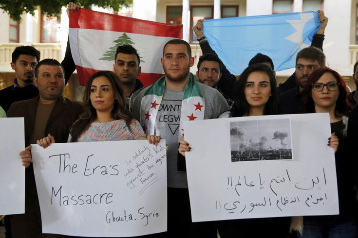 Members of Prime Minister Saad Hariri's Future Movement, hold placards during a sit-in in solidarity with residents of the Syrian capital's eastern suburbs of Ghouta, in downtown Beirut, Lebanon. (Bilal Hussein / AP) https://pow.photos/2018/lebanon-pow-22-28-february/