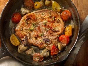 Pork Loin Chops with Tomatoes and Mushrooms - LauriPatterson / Getty Images