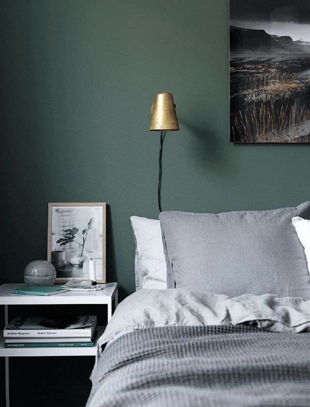 Moody green bedroom