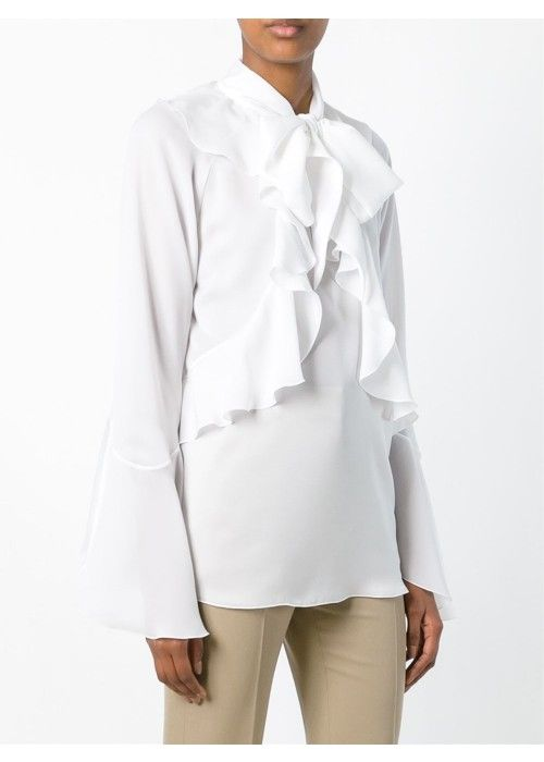 White ruffled placket blouse from Givenchy featuring a stand up collar, a ruffled design, long sleeves and a peplum hem.