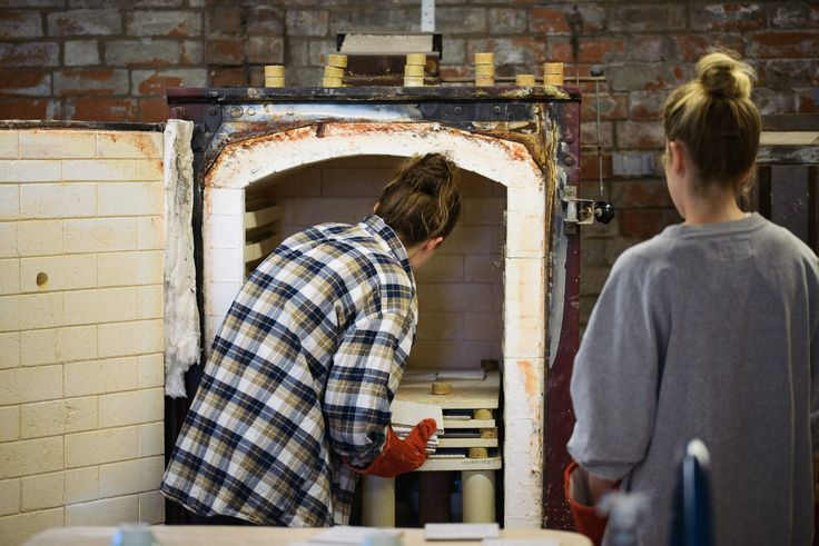 Hannah and Claire hard at work in our ceramics studio, loading the kiln with beautiful handcrafted pieces.