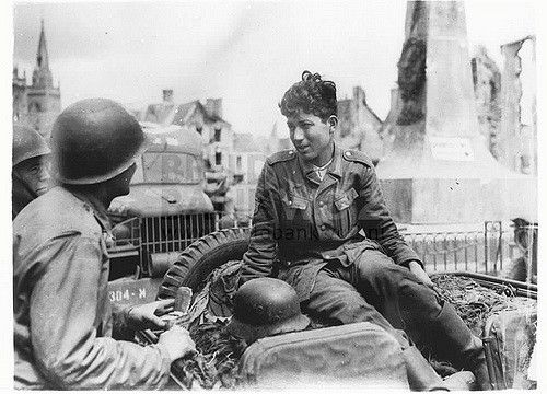 Nazi prisoner waits to surrender to Americans. A German prisoners tells American soldiers he spent three days in a foxhole waiting to surrender to U.S. forces on the La Haye du Puits front in Normandy. He said he was a Russian from Turkestari who served two years in the Russian Army before he was captured by the Germans and given the choice of serving in the Nazi Army or being shot.