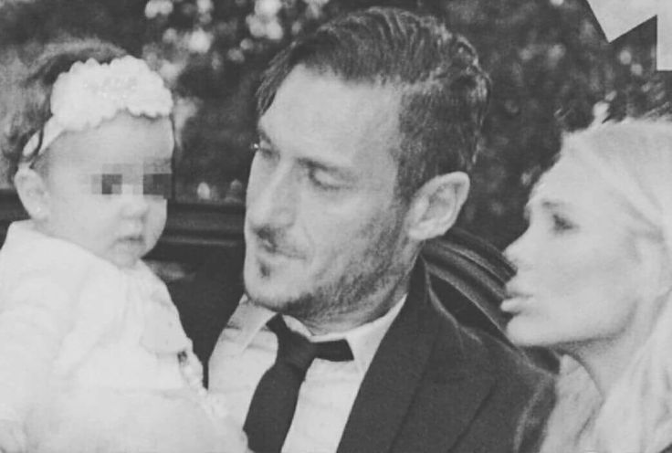 Francesco Totti with his wife Ilary Blasi and baby daughter Isabel.