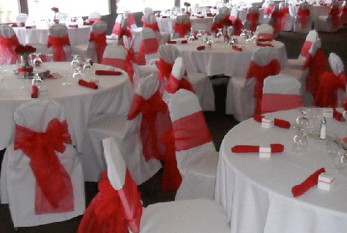 Red Bows on white chair covers for rent - Special Event Linens.