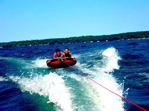 Tubing down the waters with your best friend and holding on tight, being sure not to fall off. '15