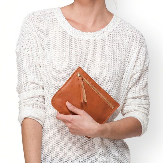 I made this leather pouch with beautiful Italian leather. It was made by hand with love for quality materials, fine workmanship and clean design. < <