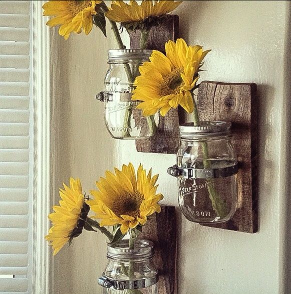 Pour some water and throw in a flower or two. This Country style hanging mason jar vase is all that and a bag of chips. Who wouldnt love this hanging in their bathroom, bedroom, or kitchen? Entirely hand made with a smooth finish and Rustic look! Created from recycled pallet wood. This Vase has beautiful colors and would look lovely in anyones home. Great home decor! This ad is for 3 vases. Custom sizing/Coloring isnt a problem just ask :) (We all have our own preferences (i.e. darker or…