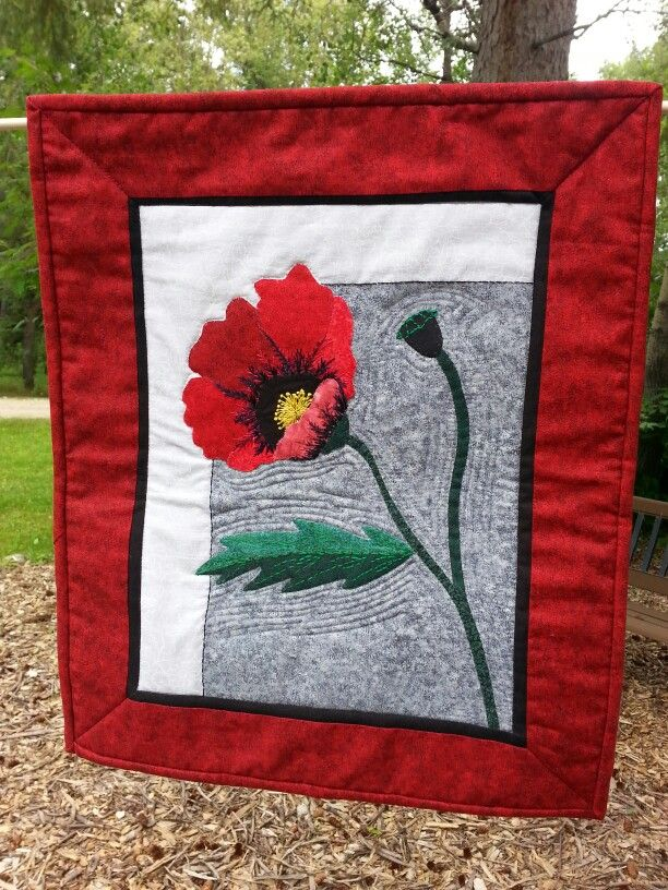 """""""For the Love of Peace"""" by Leah Passler Art quilt with machine piecing, applique, and quilting, and hand embroidery.  Made for John Voutour, veteran, 2015."""