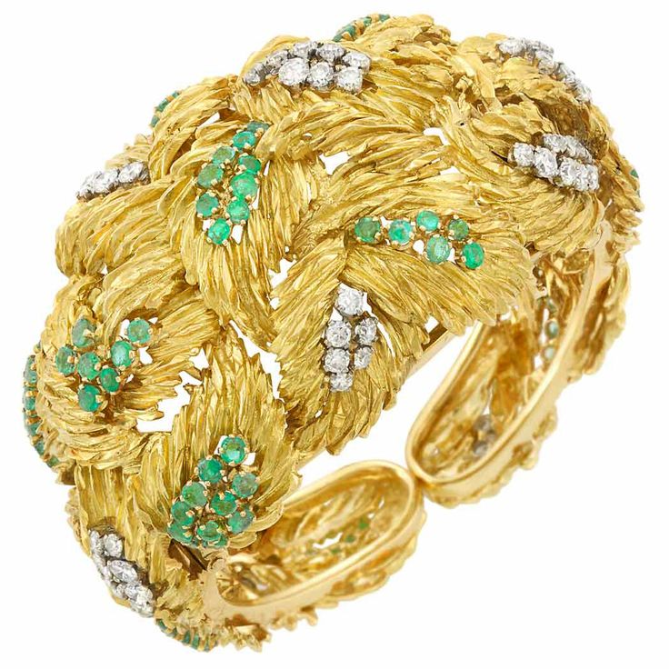 Gold, Diamond and Emerald Cuff Bangle Bracelet  18 kt., the tapered cuff composed of overlapping textured gold leaves, set with 51 round diamonds approximately 3.90 cts., accented by clusters of round emeralds, approximately 76.7 dwts. Inner circle 6 inches.