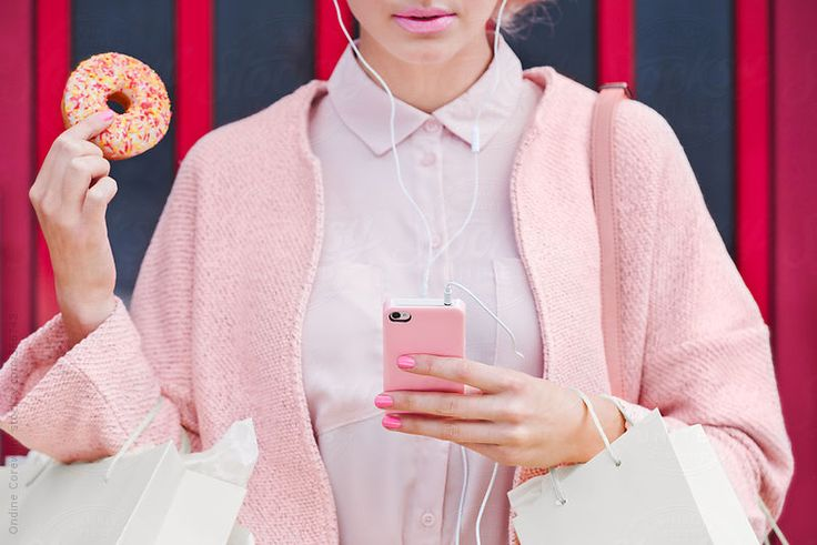 Pink Shopping Lady with doughnut using smart phone by Ondine   Stocksy United