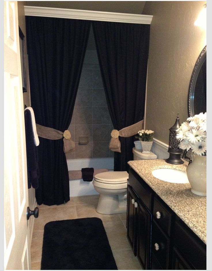What a lovely way to add class and drama to your bathroom- black heavy shower curtains!!