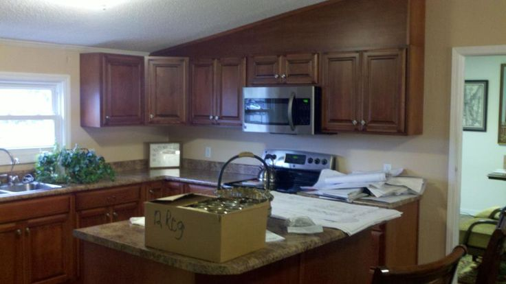 Kitchen/office with angled wood soffit.
