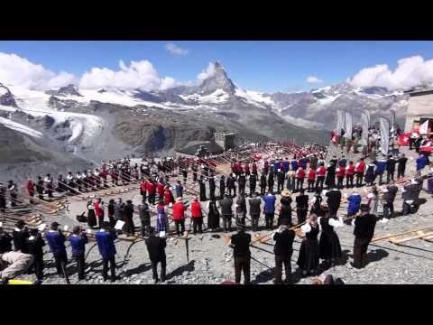 Zermatt, Switzerland - 508 alphorn players on the Gornergrat ridge breaking the world record for the largest alphorn group performance.
