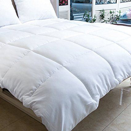 Product review for MANZOO Queen Comforter Duvet Insert White - Quilted Comforter with Corner Tabs - Hypoallergenic, Plush Siliconized Fiberfill, Box Stitched Down Alternative Comforter - Machine Washable.  - Enjoy a more restful night's sleep year-round with the MANZOO Queen Comforter Duvet Insert White. Each fluffy box stitched square is packed with luxurious siliconized fiberfill, which is a hypoallergenic alternative to traditional goose down filling. The synthetic f