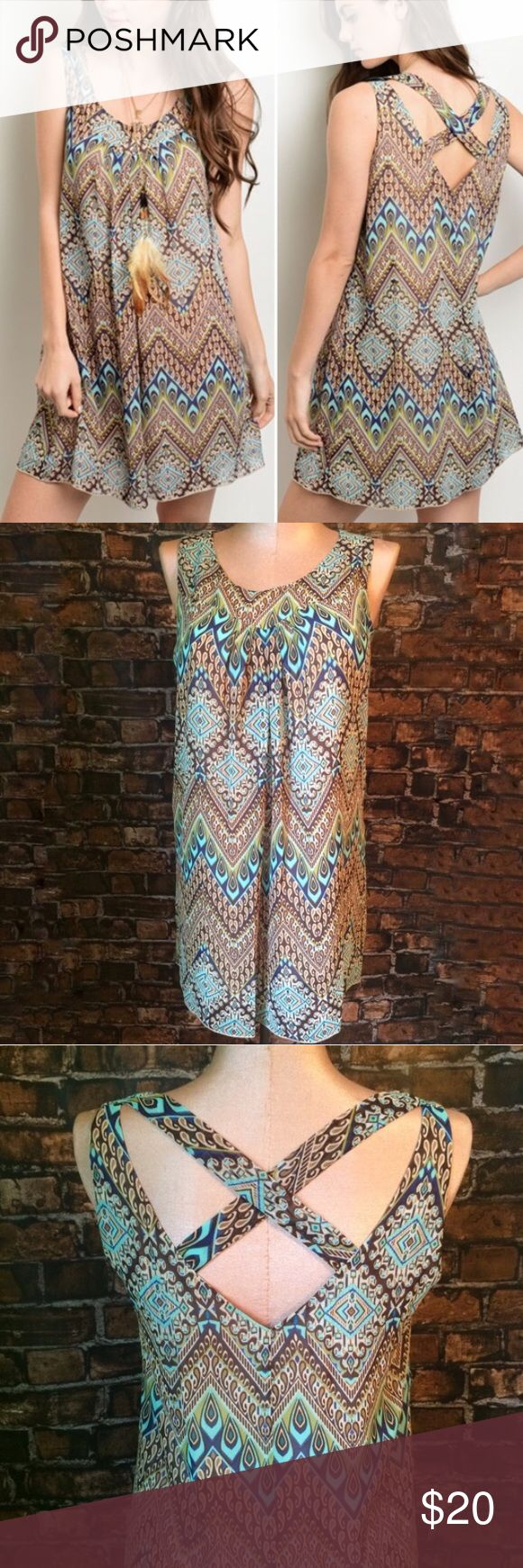 Boho swing dress - Petite sizing Sleeveless swing dress features a scooped neckline, tribal print all over in browns and blues with a relaxed fit. Criss cross back. Petite sizing. Lined. 100% polyester. Not interested in trades. Dresses