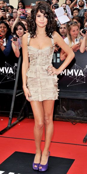 Selena Gomez looking girly and chic in an amazing tiered Burberry Prorsum minidress, violet Giuseppe Zanotti heels.