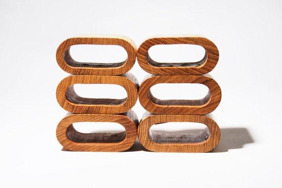 Teak Set of 6 Napkin Rings in an oblong shape.  https://www.etsy.com/listing/129900518/6-teak-napkin-rings-oval-oblong-danish?ref=shop_home_active