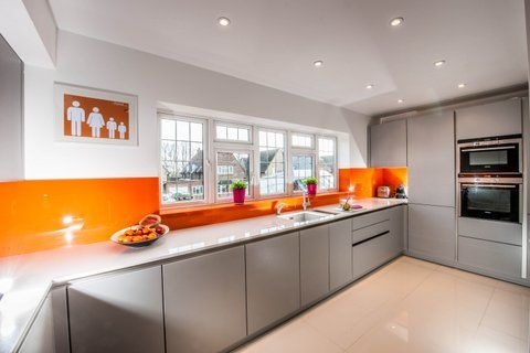 Orange splash back. Love my kitchen!