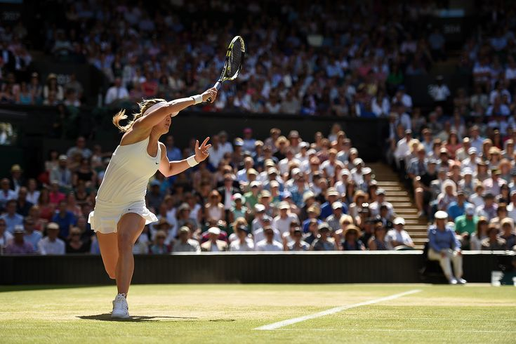 Eugenie Bouchard hits a forehand on Centre Court - Florian Eisele/AELTC