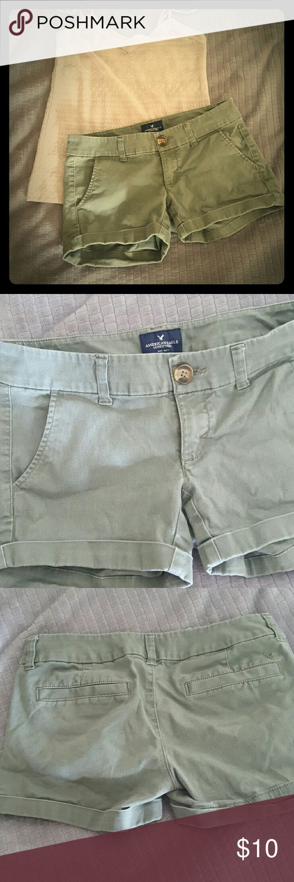 American Eagle Shorts Cute and Classic army green midi stretch shorts from American Eagle.  Faded from the wash but still has a lot of life left in them! American Eagle Outfitters Shorts