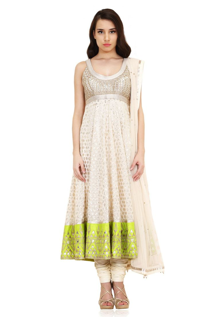 Featuring cream chandan butti in-cut sleeves kalidar kurta with broad limeraw silk gold detailed embroidery border teamed with cream cotton silk churidaar and a cream net dupatta.COMPOSITION:80��0COTTON 20��0SILKLINING – SHATOON – 80��0STAPLE 20��0VISCOSECHUDIDAR – 80��0VISCOSE 20��0POLYESTERDUPATTA – 100��0NYLONMeasurements:Size8: Complete this look with elegant chandbali's along with a pair of dull gold ankle strap shoes.