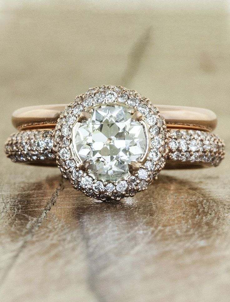 This stunning ring features a combination of a diamond studded 14k rose gold band with a 0.86ct Old European cut heirloom diamond at center.