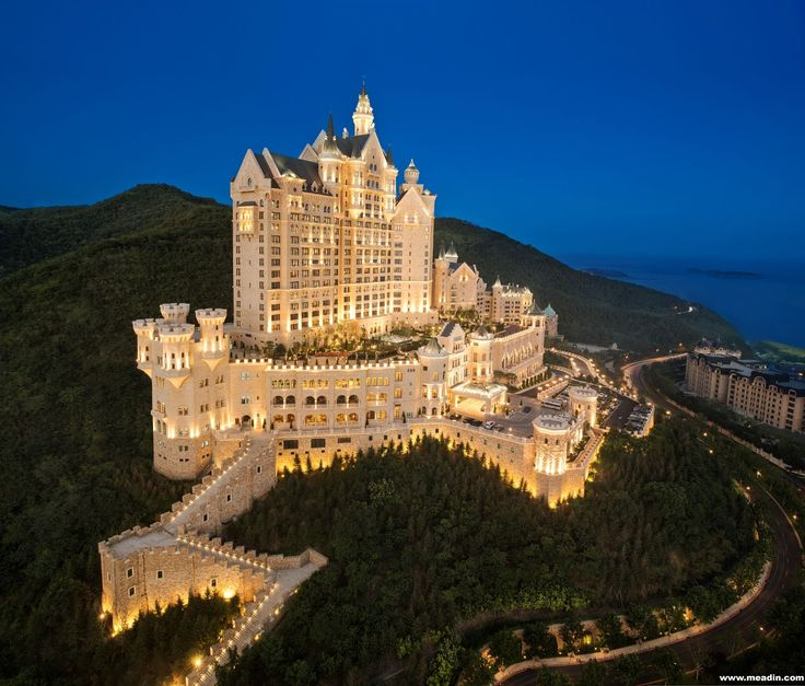 The Castle Hotel commands an imposing presence with its palatial Bavarian-style castle set amid lush foliage on Lotus Mountain in Dalian, Northeast China.
