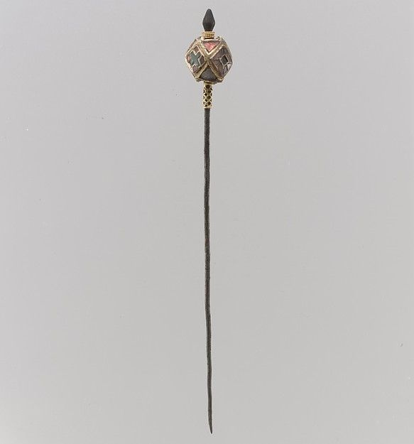 Hairpin Date: 6th century Geography: Made in Northern France Culture: Frankish Medium: Silver (pin), gold (knop) with filigree granulation, garnets Dimensions: Overall: 5 1/2 x 9/16 in. (13.9 x 1.4 cm) knop: 9/16 in. (1.4 cm)
