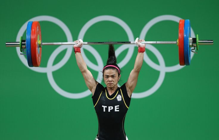 RIO DE JANEIRO, BRAZIL - AUGUST 07: Shu-Ching Hsu of Chinese Taipei competes during the Women's 53kg Group A weightlifting contest on Day 2 of the Rio 2016 Olympic Games at Riocentro - Pavilion 2 on August 7, 2016 in Rio de Janeiro, Brazil. (Photo by Lars Baron/Getty Images) via /AOL_Lifestyle/