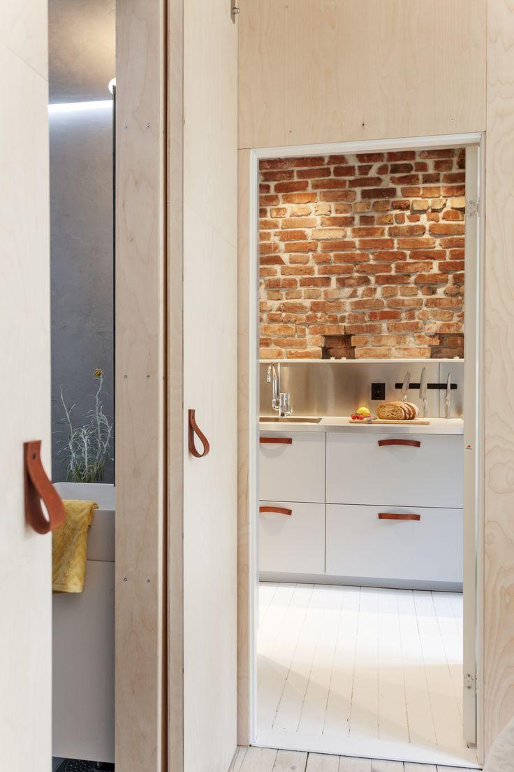 Leather handles, brickwall, kitchen, playwood slidingdoor. Architect/designer, Lisa Wettsjö+Gustav Wettsjö