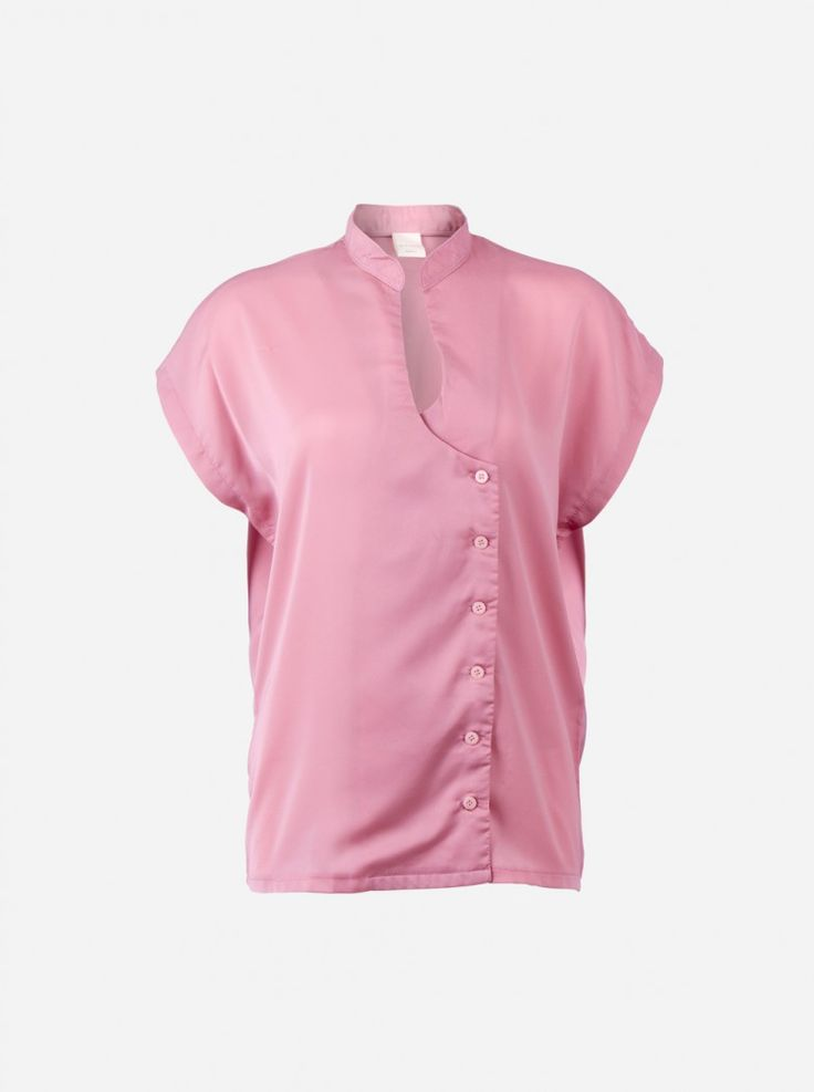 A plain simple loose shirt with shanghai style collar made of silky fabric. The shirt features low neck line with slightly-sided button in a wrap style.