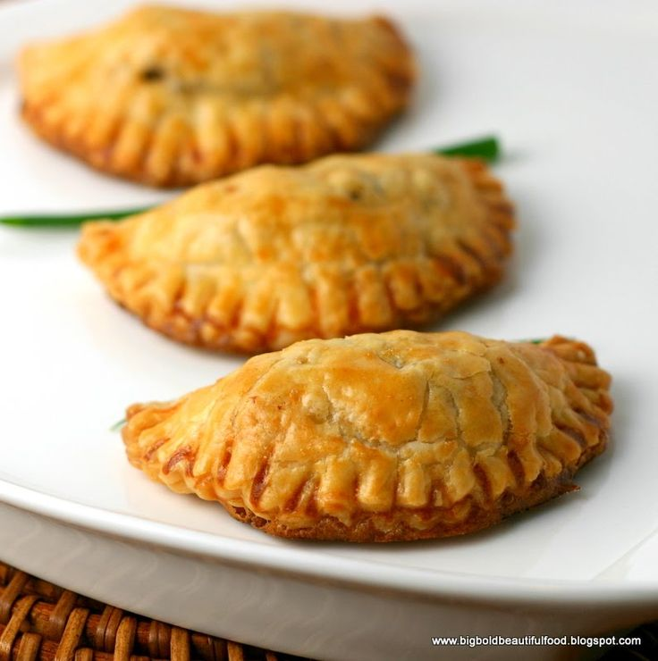 Filipino Beef Empanadas; These turnovers are encased in a flaky pastry dough and filled with a simple filling of beef, potatoes, and raisins. They are normally deep-fried, but they can be baked as well.