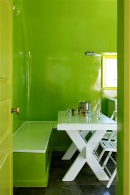 Amazing-Green-DinningRoom-White-Table-Built-Sofa-Oia-VillaforRent-Santorini-Greece-Honeymoon-Holidays