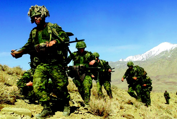 The Canadian military has been in combat for longer than both world wars combined. These members of the Princess Patrica's Canadian Light Infantry were photographed in Afghanistan 2002. Image courtesy cpl. Lou Penney, GT 3 PPCLI  Photograph by: Cpl Lou Penney , DND/Cpl Lou Penney