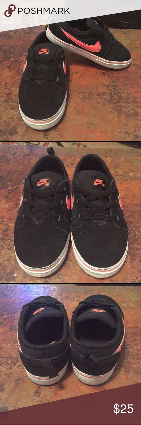 Girls Nike shoes size ten Darling pair of girls Nike shoes. Black with orange swoosh. Worn once. See pic for exact condition. From clean pet and smoke free home Nike Shoes