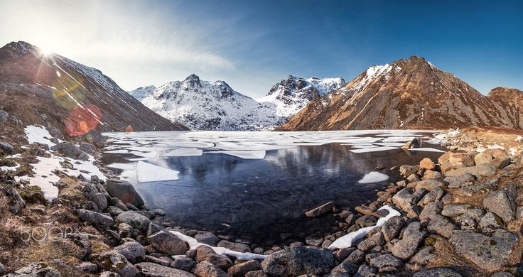 Unstad panorama - Frozen Utdalsvatnet lake under the Unstad mountain in Lofoten, Norway