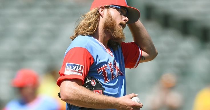 A.J. Griffin reacts after giving up back to back home runs to the A's in the second inning 8-27-2017. The Rangers were swept in the three-game series against the team with the second-worst record in the AL. (Photo by Thearon W. Henderson/Getty Images)
