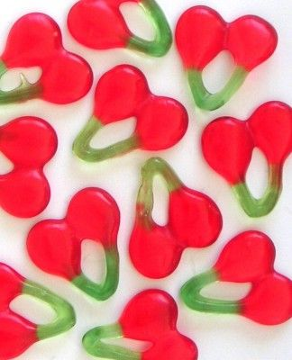 Haribo Cherries. My sister and I used to break them in two and hang them on our ears before eating. Haribo snoep kersen.