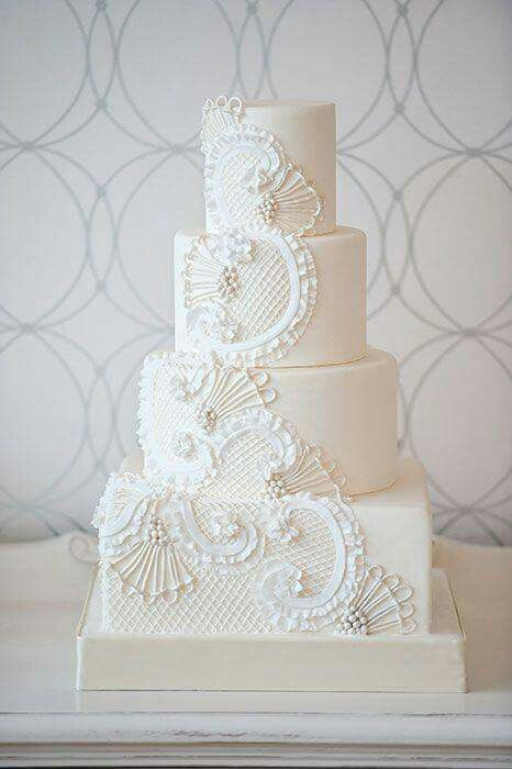 All white, this would be gorgeous in lavender and white also, love the fan and lace details
